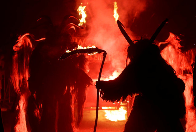 Men dressed as devils perform during a Krampus show, the traditional parade where people in costumes and masks perform an old ritual to disperse the ghosts of winter, in the southern Bohemian town of Kaplice, December 10, 2016. (Photo by David W. Cerny/Reuters)