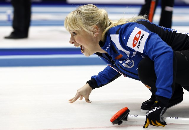 Finland's skip Saana Puustinen instructs her team mates after delivering a stone during their curling round robin game against Germany during the World Women's Curling Championships in Sapporo March 16, 2015. (Photo by Thomas Peter/Reuters)
