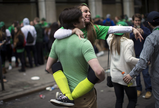 Revelers embrace as they attend the 254th New York City St. Patrick's Day parade along 5th Avenue in Manhattan Borough of New York, March 17, 2015. (Photo by Mike Segar/Reuters)