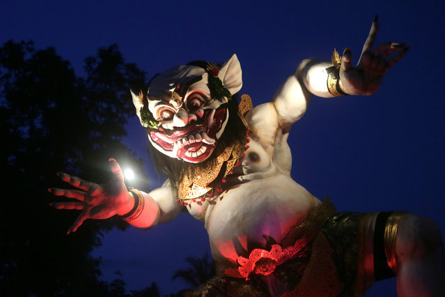 "A view of one of the giant effigies in the form of devil, locally named as ""Ogoh-ogoh"" carried by Balinese during a parade before the Nyepi Day, the Balinese Day of Silence, that marks Balinese Hindu New Year in Gianyar, Bali, Indonesia, March 19, 2015. (Photo by Made Nagi/EPA)"