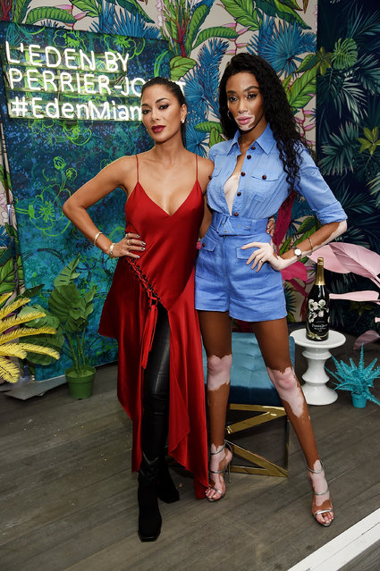 Nicole Sherzinger and Winnie Harlow attend Vladimir Restoin Roitfeld And Hilary Rhoda Attend L'Eden By Perrier-Jouet To Celebrate Launch Of CR WOMEN 2019 at Faena Beach on December 6, 2018 in Miami Beach, Florida. (Photo by Dimitrios Kambouris/Getty Images for Perrier-Jouet)