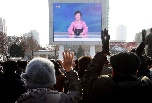 North Koreans watch a news broadcast on a video screen outside Pyongyang Railway Station in Pyongyang, North Korea, Wednesday, January 6, 2016. (Photo by Wong Maye-E/AP Photo)