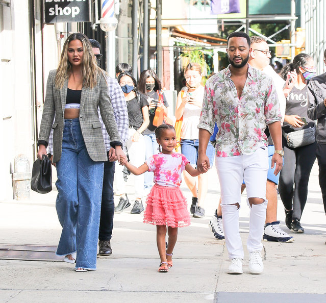 American singer John Legend and American model and television personality Chrissy Teigen seen walking around NYC with their daughter Luna on August 19, 2021. (Photo by The Mega Agency)