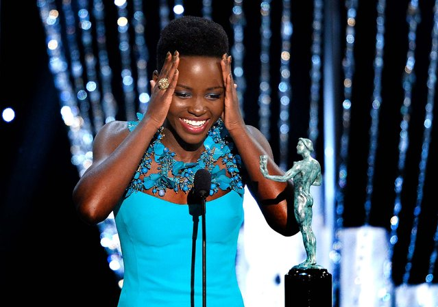 """Lupita Nyong'o accepts the Outstanding Performance by a Female Actor in a Supporting Role award for """"12 Years a Slave"""". (Photo by Kevork Djansezian/Getty Images)"""