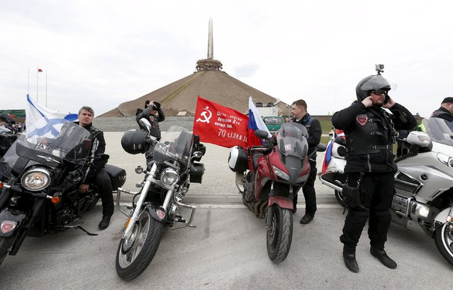 Members of the Night Wolves motorcycle club and other local Belarusian bikers arrive at the war memorial Mound of Glory during a bike ride commemorating the 70th anniversary of the victory over Nazi Germany in World War Two, outside Minsk April 26, 2015. Germany will block some members of an ultra-nationalist Russian motorcycle club from entering the country, government sources said on Saturday, a day after Poland also announced an entry ban for the group which is blacklisted by the United States. (Photo by Vasily Fedosenko/Reuters)