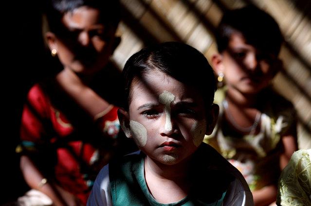 Rohingya refugee children sit inside a classroom at Kutupalong refugee camp, near Cox's Bazar, Bangladesh, January 4, 2018. (Photo by Tyrone Siu/Reuters)