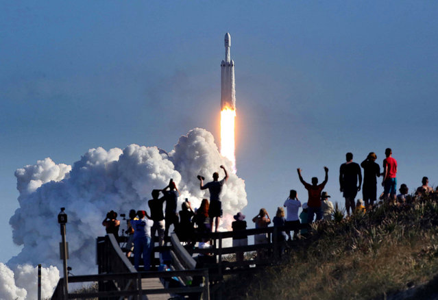 The crowd cheers at Playalinda Beach in the Canaveral National Seashore, just north of the Kennedy Space Center, during the succesful launch of the SpaceX Falcon Heavy rocket on February 6, 2018. Playalinda is one of closest public viewing spots to see the launch, about 3 miles from the SpaceX launchpad 39A. (Photo by Joe Burbank/TNS via ZUMA Wire)