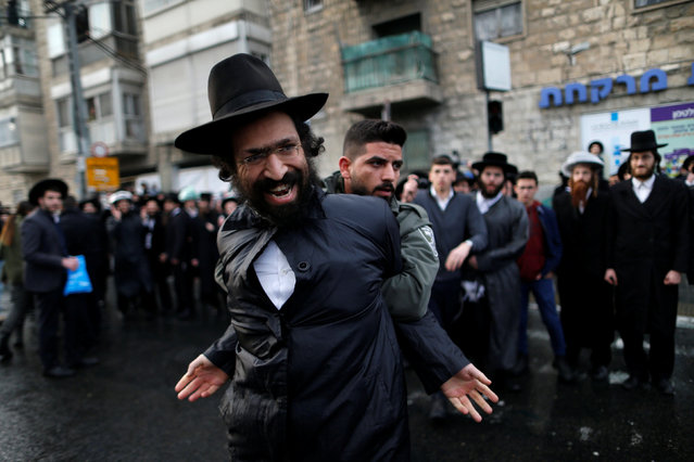Ultra-Orthodox Jewish protestor is detained by an Israeli border policeman during a demonstration against members of their community serving in the Israeli army, part of ongoing demonstrations recently seen throughout Israel, in Jerusalem February 9, 2017. (Photo by Ammar Awad/Reuters)