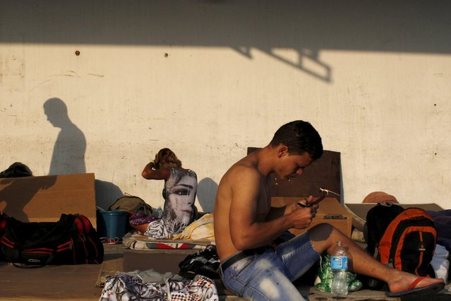 Cuban migrant gets ready for the day at a provisional shelter in Paso Canoas, border with Costa Rica, in Panama March 21, 2016. (Photo by Carlos Jasso/Reuters)