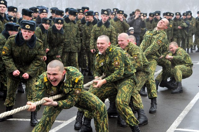 Belarus Interior Ministry servicemen take part in a competition to mark the Defenders of the Fatherland Day at their training centre outside Minsk, on February 23, 2014. (Photo by Viktor Drachev/AFP Photo)