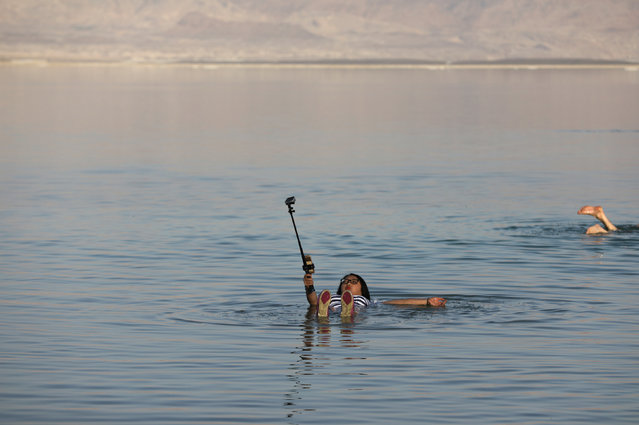A woman takes a selfie as she floats in the Dead Sea in Ein Bokeq, Israel February 20, 2017. (Photo by Ammar Awad/Reuters)