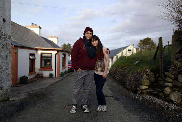 Clare Barrett Butler, 37, and her daughter Lily Barrett McHugh, 11, pose for a photograph outside their house in a small hamlet near the village of Ardara in County Donegal February 27, 2014. Clare says she is a homemaker and a mother, and she is continuing her education with courses at college. Clare says that as a child she wanted to work on the special effects of movies or as a stuntwoman. She says that she would love her daughter Lily to follow her dreams and become a hairdresser. (Photo by Cathal McNaughton/Reuters)