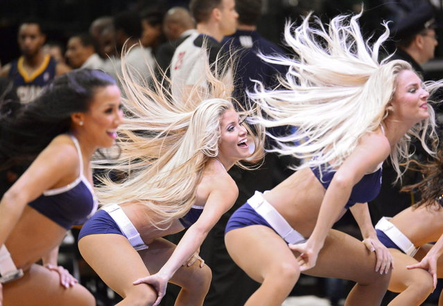 The dancers of the Dallas Mavericks during timeout against the Indiana Pacers in the first half of their basketball game NBA at American Airlines Center in Dallas, Texas, on March 10, 2014. (Photo by Larry W. Smith/EFE)