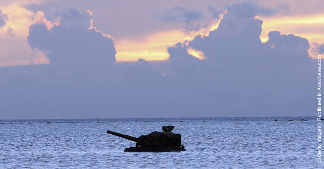 A tank remains in the sea close to a monument to the hundreds of Japanese civilians and soldiers who jumped off Banzai Cliff to their deaths to avoid capture by the invading American army at Banzai Cliff on June 26, 2005 in Saipan, Northern Mariana Islands