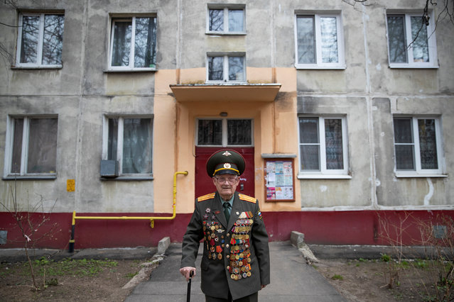 World War Two veteran Nikolay Bagayev, 100, poses for a picture dressed in his uniform, in front of his apartment block in Korolyov, north of Moscow, Russia on April 18, 2019. (Photo by Maxim Shemetov/Reuters)
