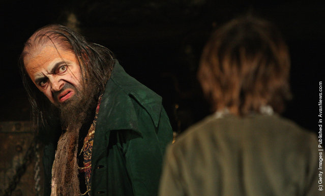 Rowan Atkinson (L) performs in the role of Fagin during a rehearsal of Lionel Bart's musical  adaptation of Oliver