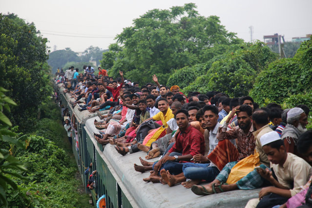 People travel home on an overcrowded train to celebrate Eid with family and friends in Dhaka, Bangladesh on June 3, 2019. (Photo by Rehman Asad/Barcroft Media)