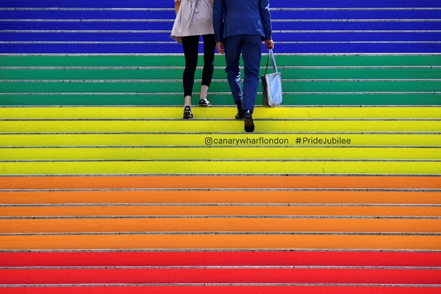 A couple walk up some newly decorated staircase at Canary Wharf in London, Britain, July 1, 2019. (Photo by Dylan Martinez/Reuters)