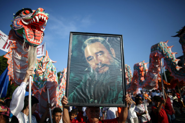 People carrie a picture of  Cuba's former President Fidel Castro during a May Day rally in Havana, Cuba, May 1, 2016. (Photo by Alexandre Meneghini/Reuters)