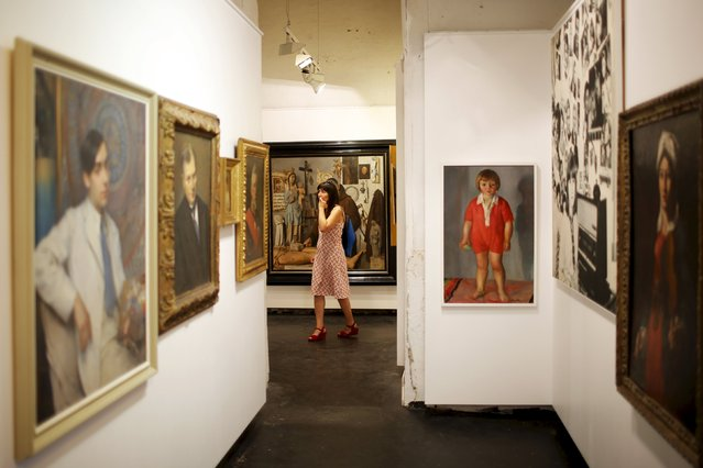 """A woman looks at works at the Temple du Gout during a media visit to """"A Journey to Nantes"""" (Le Voyage a Nantes) art festival in Nantes, France, June 30, 2015. (Photo by Stephane Mahe/Reuters)"""