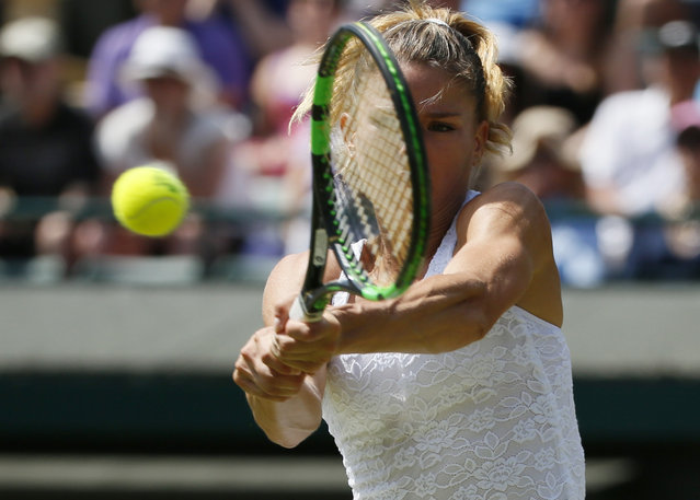 Camila Giorgi of Italy hits the ball during her match against Caroline Wozniacki of Denmark at the Wimbledon Tennis Championships in London, July 4, 2015. (Photo by Stefan Wermuth/Reuters)