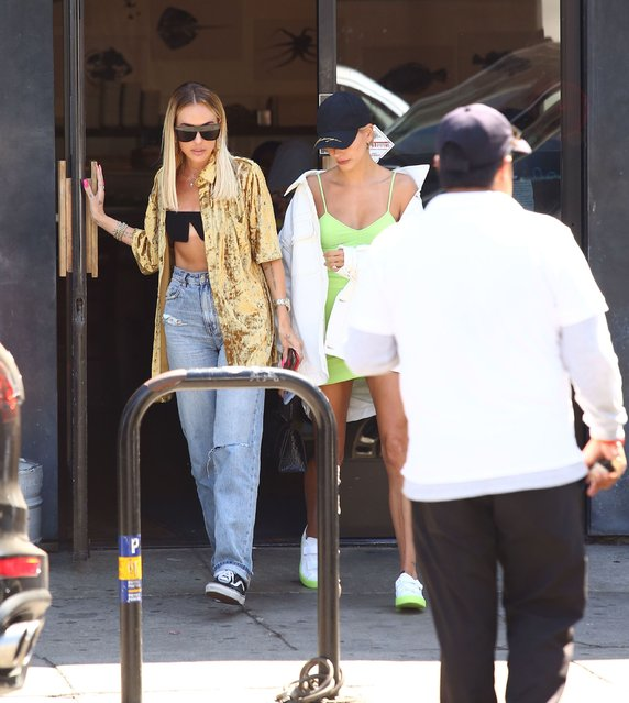 Hailey Baldwin dons an oversized whitewashed denim jacket and displays her leggy frame during a sushi date in Hollywood with a girlfriend Tuesday, August 20, 2019.  Hailey didn't feel like doing her hair so threw on a baseball cap to hide her blonde locks. (Photo by X17/SIPA Press)