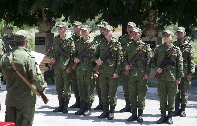 Servicemen of the military forces of South Ossetia attend an oath of allegiance ceremony in Tskhinvali, the capital of the breakaway region of South Ossetia, Georgia, July 5, 2015. (Photo by Kazbek Basaev/Reuters)