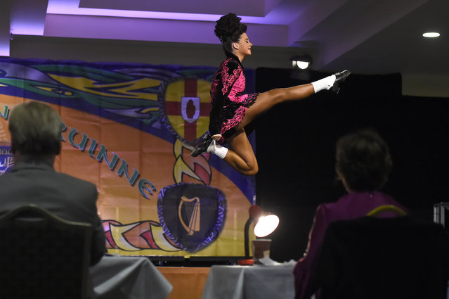 A dancer performs before a judging panel during the World Irish Dancing Championships in Dublin, Ireland on April 11, 2017. (Photo by Clodagh Kilcoyne/Reuters)