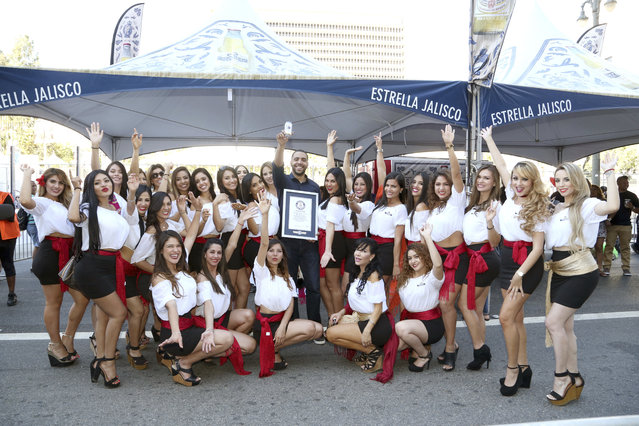 Joel Paulino, Senior Brand Manager Estrella Jalisco, celebrates the new Guinness Word Record for the largest game of Loteria during Fiesta Broadway with Estrella Jalisco on Sun., April 30, 2017, in Los Angeles. (Photo by Casey Rodgers/Invision for Estrella Jalisco/AP Images)