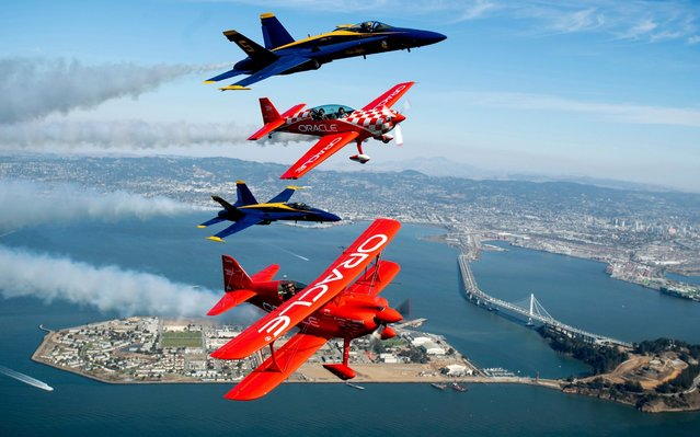 In advance of Fleet Week performances, U.S. Navy Blue Angels fly above San Francisco with Team Oracle aerobatics pilots Sean D. Tucker and Jessy Panzer on Thursday, October 10, 2019. (Photo by Noah Berger/AP Photo)
