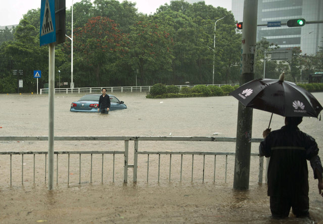 Vehicles are submerged in the streets on May 11, 2014 in Shenzhen, Guangdong Province of China. China's southern city Shenzhen experienced its strongest rainfall since 2008, which caused parts of the city to flood. The city's meteorological bureau issued a red alert for heavy rain, the highest level of the four-tier alert system. (Photo by ChinaFotoPress/ChinaFotoPress via Getty Images)