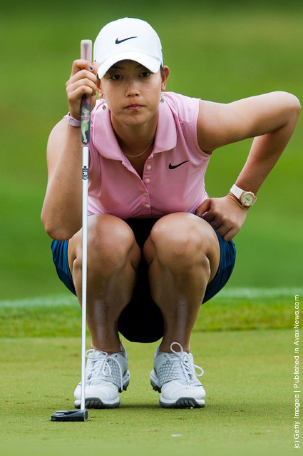 Michelle Wie of USA lines a putt on the 1st hole during day three of the LPGA Thailand at Siam Country Club