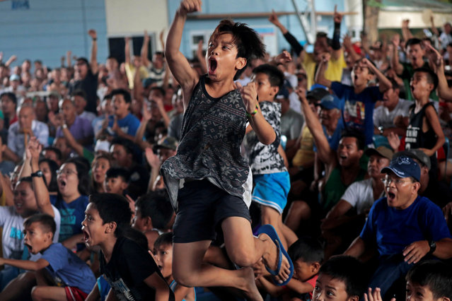 Filipino boxing fans react as they watch the WBA Welterweight match between Philippine boxing icon Manny Pacquiao and Keith Thurman of the U.S. in a live public viewing in Marikina, Philippines, July 21, 2019. (Photo by Eloisa Lopez/Reuters)