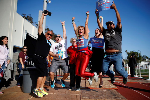 Supporters jump for a friend's photo as they wait for U.S. Democratic presidential candidate Bernie Sanders to speak in Santa Monica, California, U.S. May 23, 2016. (Photo by Lucy Nicholson/Reuters)