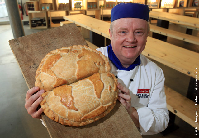 Head chef Tony Henshaw poses for a photograph with a giant pasty shaped as the globe at the World Cornish Pasty Championships at The Eden Project