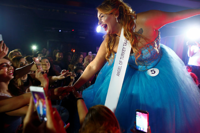 """Contestant Duru Colgulu celebrates after awarded with a """"Sympathy prize"""" during the Angel of Turkey transgender/transsexual beauty pageant in Istanbul, Turkey, May 26, 2016. (Photo by Murad Sezer/Reuters)"""