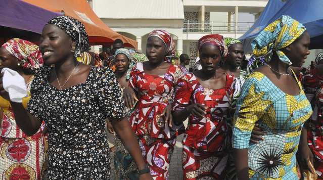 Recently freed schoolgirls prior to being reunited with their parents, in Abuja, Nigeria, Saturday, May 20, 2017. The 82 Nigerian schoolgirls recently released after more than three years in Boko Haram captivity reunited with their families for the first time Saturday, as anxious parents looked for signs of how deeply the extremists had changed their daughters' lives. (Photo by Olamikan Gbemiga/AP Photo)