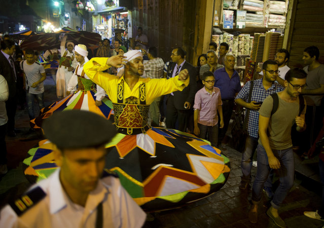 In this Sunday, June 5, 2016 photo, whirling dervishes spin during a performance marking the first day of the holy month of Ramadan in Cairo, Egypt. (Photo by Amr Nabil/AP Photo)