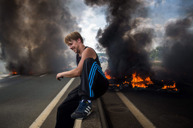 Ferry workers burn tyres on both lanes of a road leading to the port of Calais on July 31, 2015 in Calais, France. Employees of My Ferry Link blocked the key route leading to the port as part of an ongoing dispute over job losses. Strike action and daily attempts by hundreds of migrants to enter the Channel Tunnel and onto trains heading to the United Kingdom is causing delays to passenger and freight services across the channel. (Photo by Rob Stothard/Getty Images)