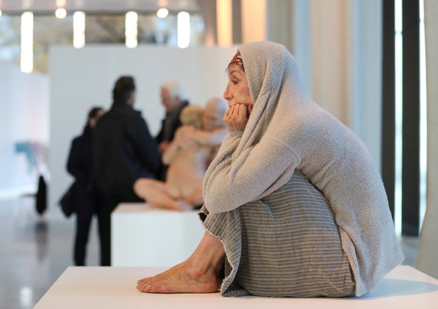 """A hyperrealist artwork called """"Cornered"""" by Marc Sijan is seen at the hyperrealism sculptures exhibition """"Ceci n'est pas un corps"""" in Liege, Belgium, November 20, 2019. (Photo by Yves Herman/Reuters)"""