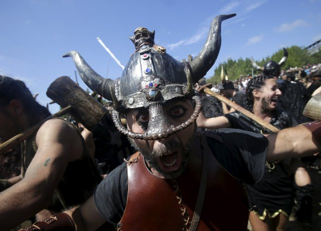 A man dressed up as a Viking shouts during the annual Viking festival of Catoira in north-western Spain August 2, 2015. (Photo by Miguel Vidal/Reuters)