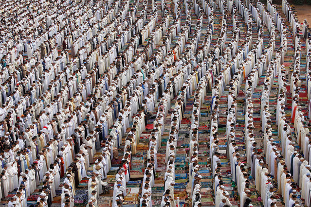 People attend Eid al-Fitr prayers to mark the end of the holy fasting month of Ramadan at a play ground in the suburb of Sale, Morocco June 26, 2017. (Photo by Youssef Boudlal/Reuters)
