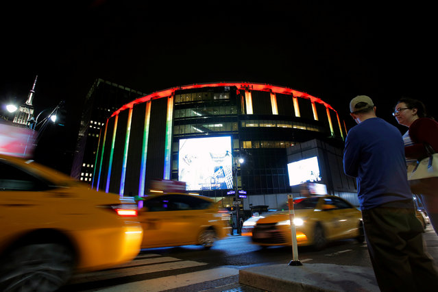Madison Square Garden is lit in rainbow colors to honor the victims of the Orlando shooting massacre at the Pulse nightclub, in the Manhattan borough of New York, U.S., June 13, 2016. (Photo by Andrew Kelly/Reuters)