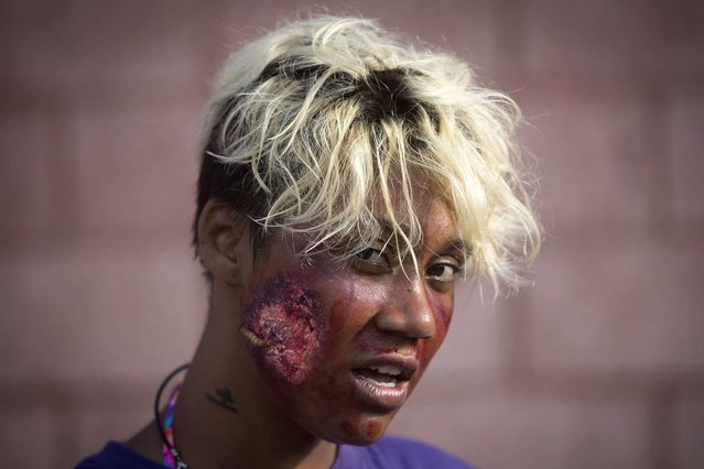 """A participant of the """"Zombie Takeover of Coney Island"""" poses for a portrait in Coney Island in the Brooklyn borough of New York, July 2, 2014. (Photo by Carlo Allegri/Reuters)"""