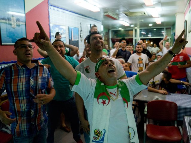 Spain: Algerian fans celebrate their victory over Russia. (Photo by Myriam Meloni)