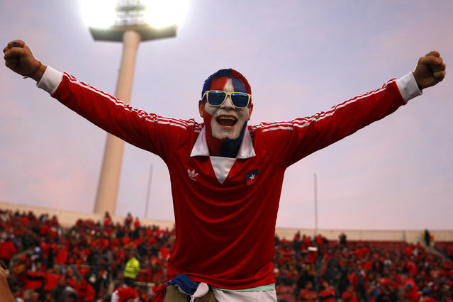 A fan of Chile cheers for his team prior the 2015 Copa America Chile quarter final match between Chile and Uruguay at Nacional Stadium on June 24, 2015 in Santiago, Chile. (Photo by Felipe Zanca/LatinContent/Getty Images)