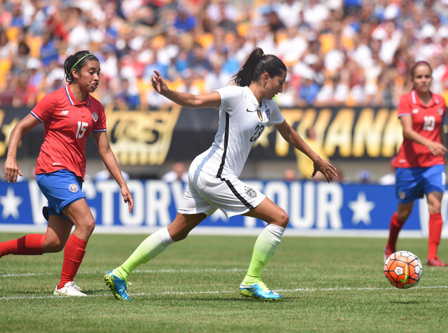 United States forward Christen Press (23) beats Costa Rica midfielder Cristin Granados (15) to score a goal during the first half of a women's friendly soccer match on Sunday, August 16, 2015, in Pittsburgh. (Photo by Don Wright/AP Photo)