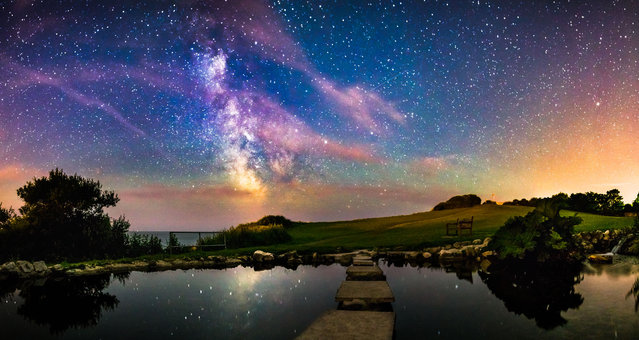 A panoramic image shows the reflection of the Milky Way in the glass-like water of Flowers Brook, on June 22, 2014, in Isle of Wight, UK. (Photo by Chad Powell/Barcroft Media)