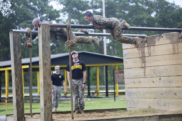 Captain Kristen Griest (R) participates in an obstacle course during training at the U.S. Army Ranger School on Ft. Benning Georgia, June 23, 2015. (Photo by Staff Sgt. Scott Brooks/Reuters/U.S. Army)