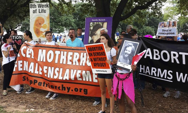 Abortion rights activists protest outside a U.S. federal court in Austin, Texas August 4, 2014 where a hearing started to hear a case by the Center for Reproductive Rights against a new set of restrictions on abortion clinics in the state that go into effect in September. (Photo by Jon Herskovitz/Reuters)